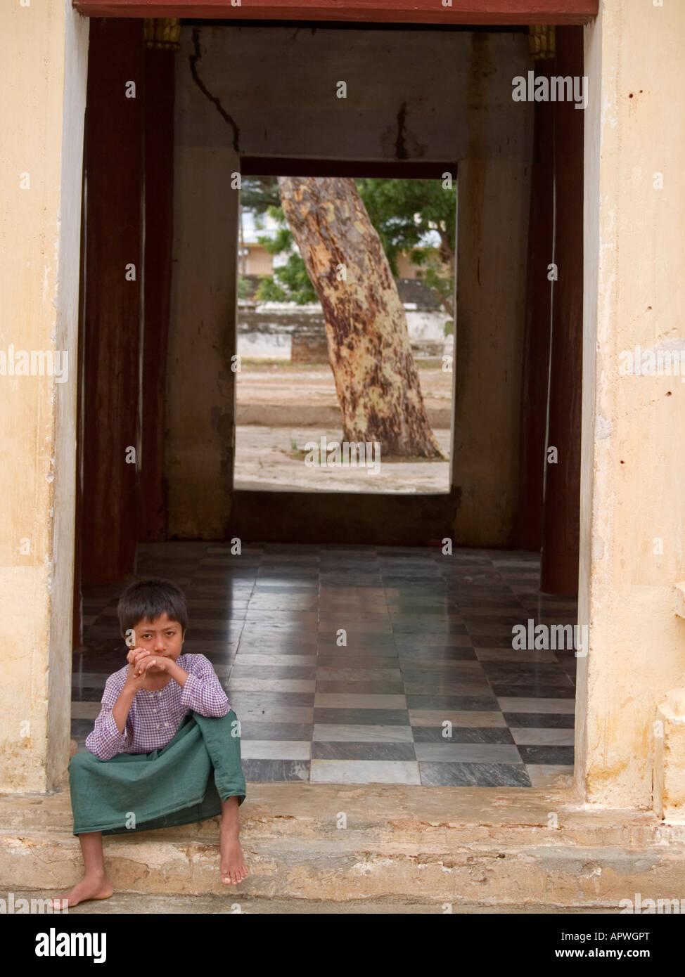 boy in a doorframe in Bagan Myanmar - Stock Image