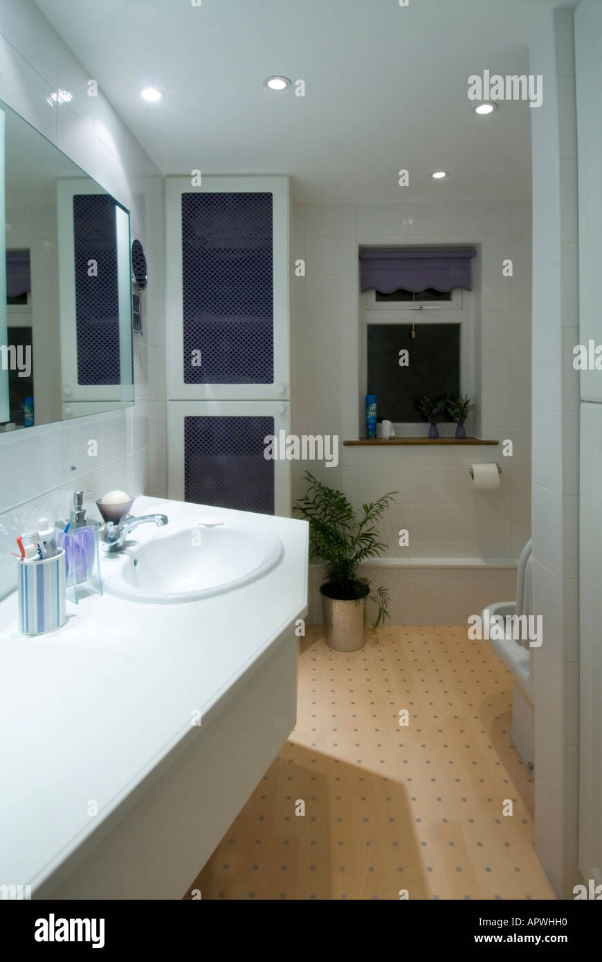 House interior bathroom vanity unit with mirror & wash hand basin includes boiler & airing cupboard make over new Stock Photo
