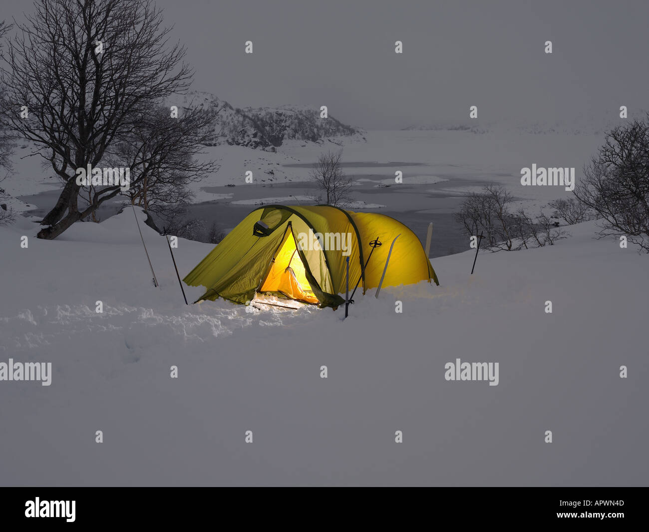 Yellow tent in the snow - Stock Image