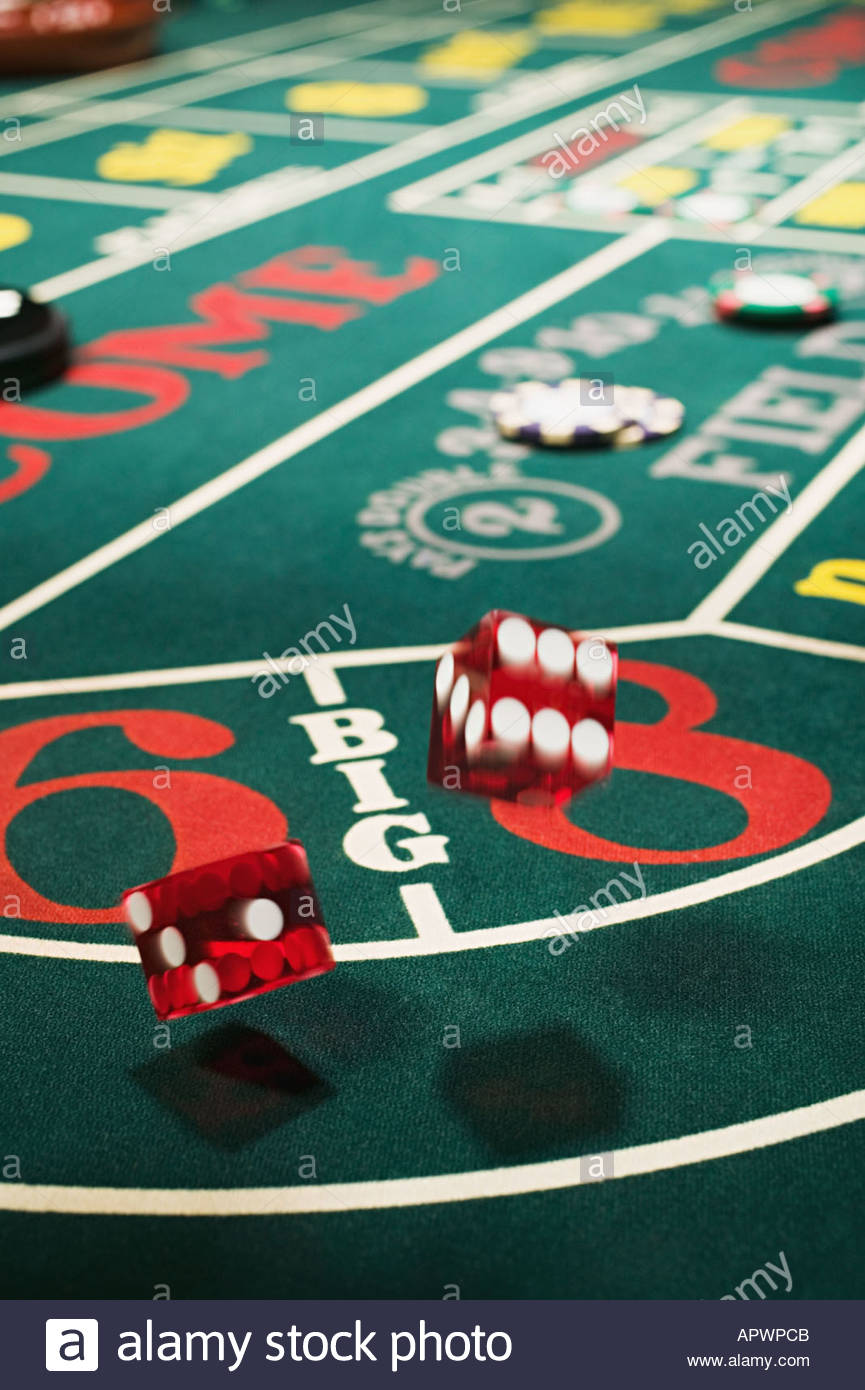 Dice on a craps table - Stock Image
