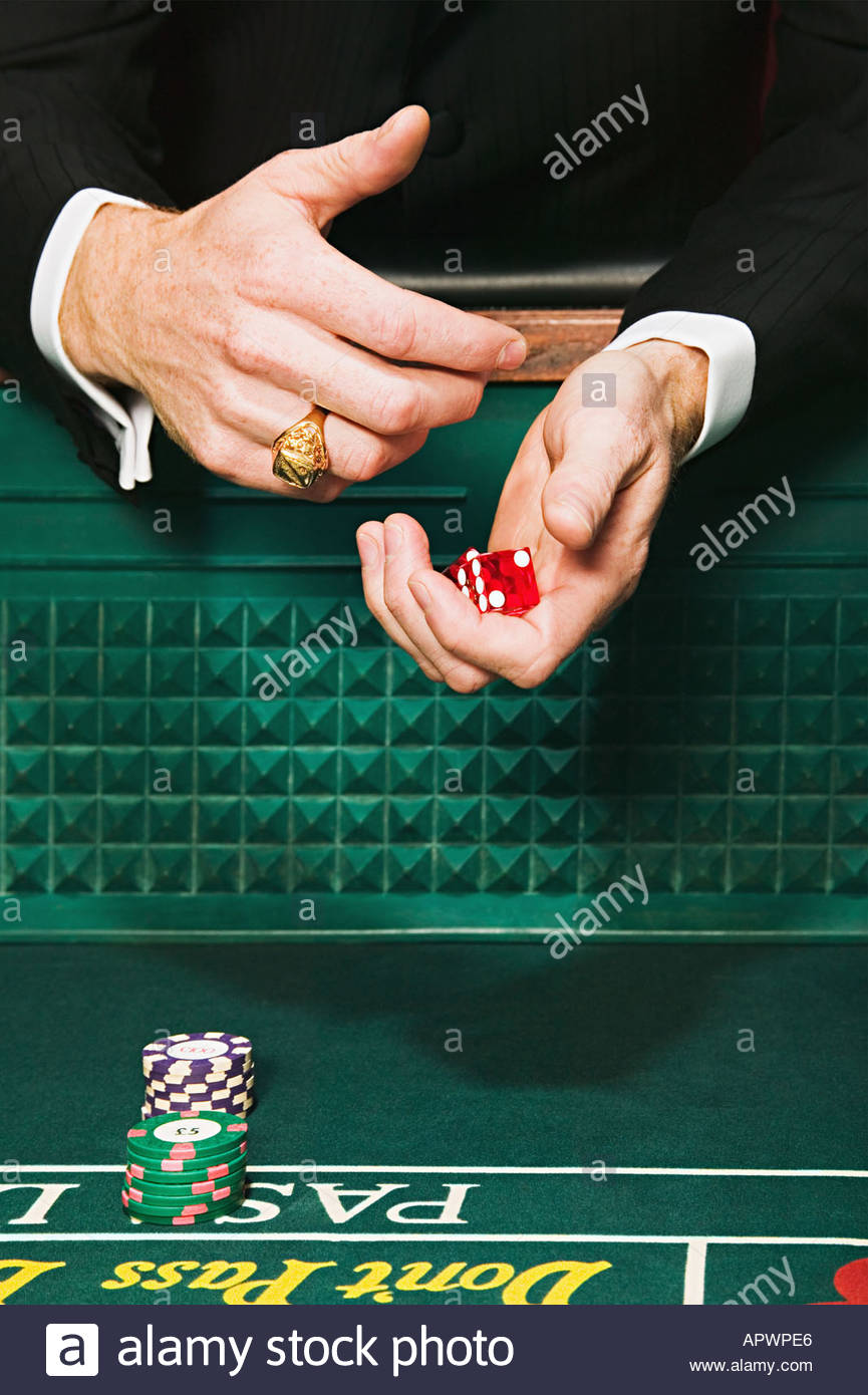 Man holding craps dice - Stock Image