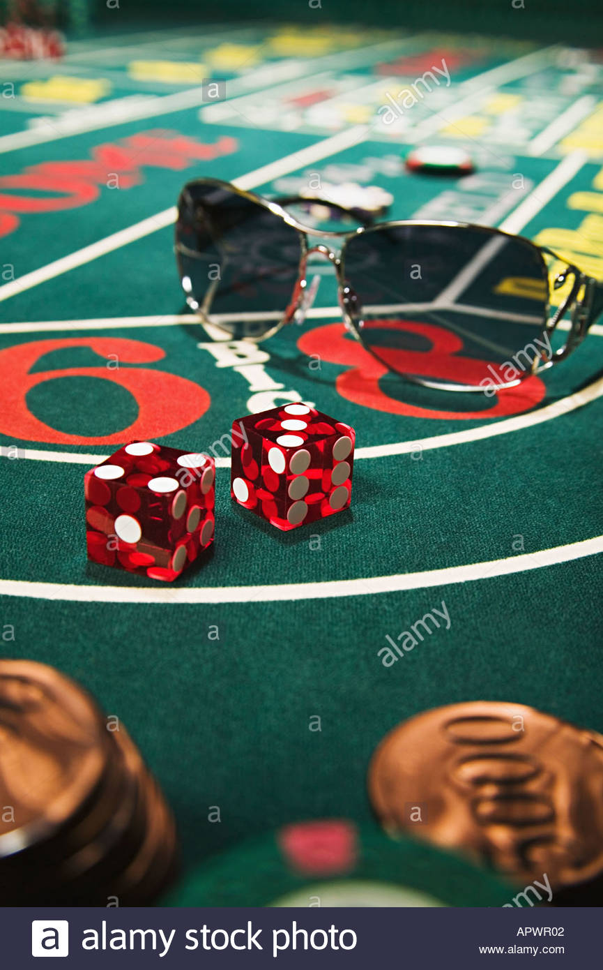 Sunglasses on a craps table - Stock Image