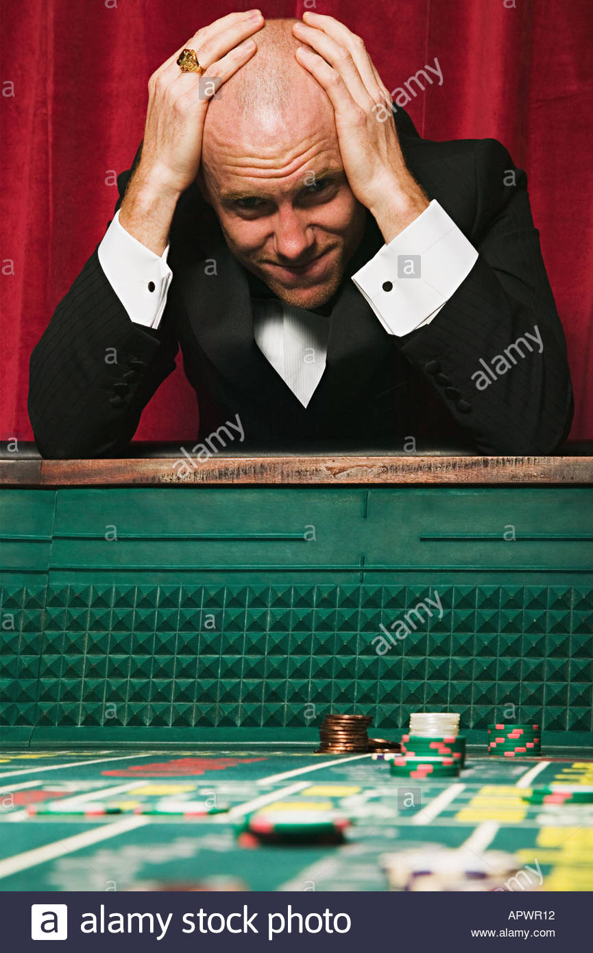 Man losing at craps - Stock Image