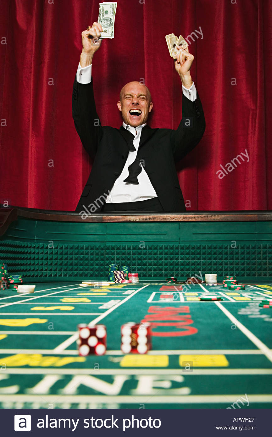 Man winning at craps - Stock Image