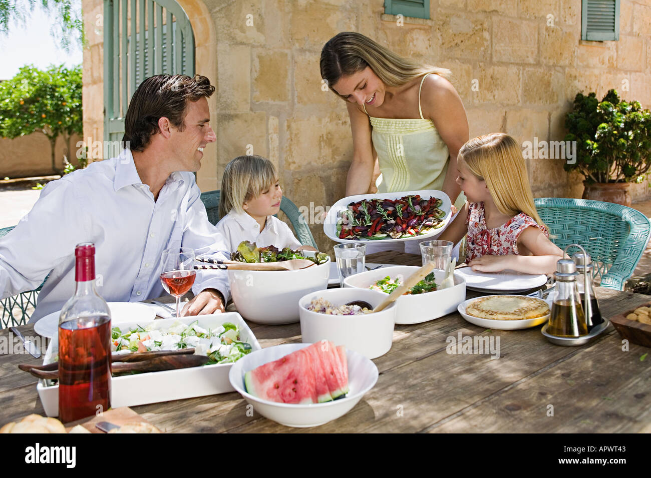 Family dining al fresco - Stock Image