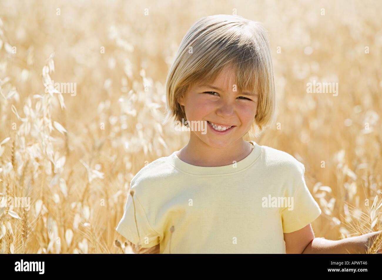 Boy in a wheat field Stock Photo