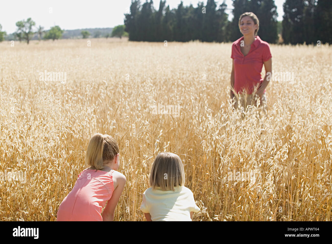 Mother and children playing hide and seek Stock Photo