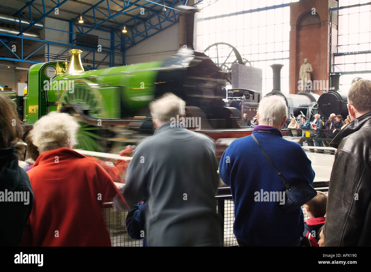 Stirling Single No1 locomotive on the turntable at the National Railway Museum York watched by visitors - Stock Image