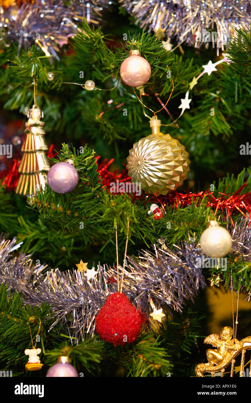Christmas tree with traditional old-fashioned decorations and tinsel ...