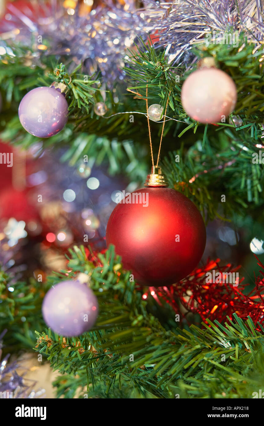 Christmas decorations with tinsel and red bauble - Stock Image
