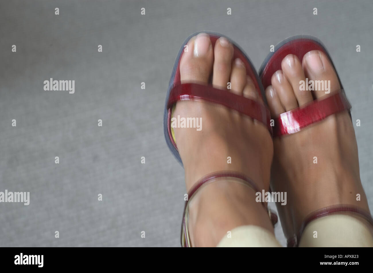 feet in red strappy sandals Stock Photo