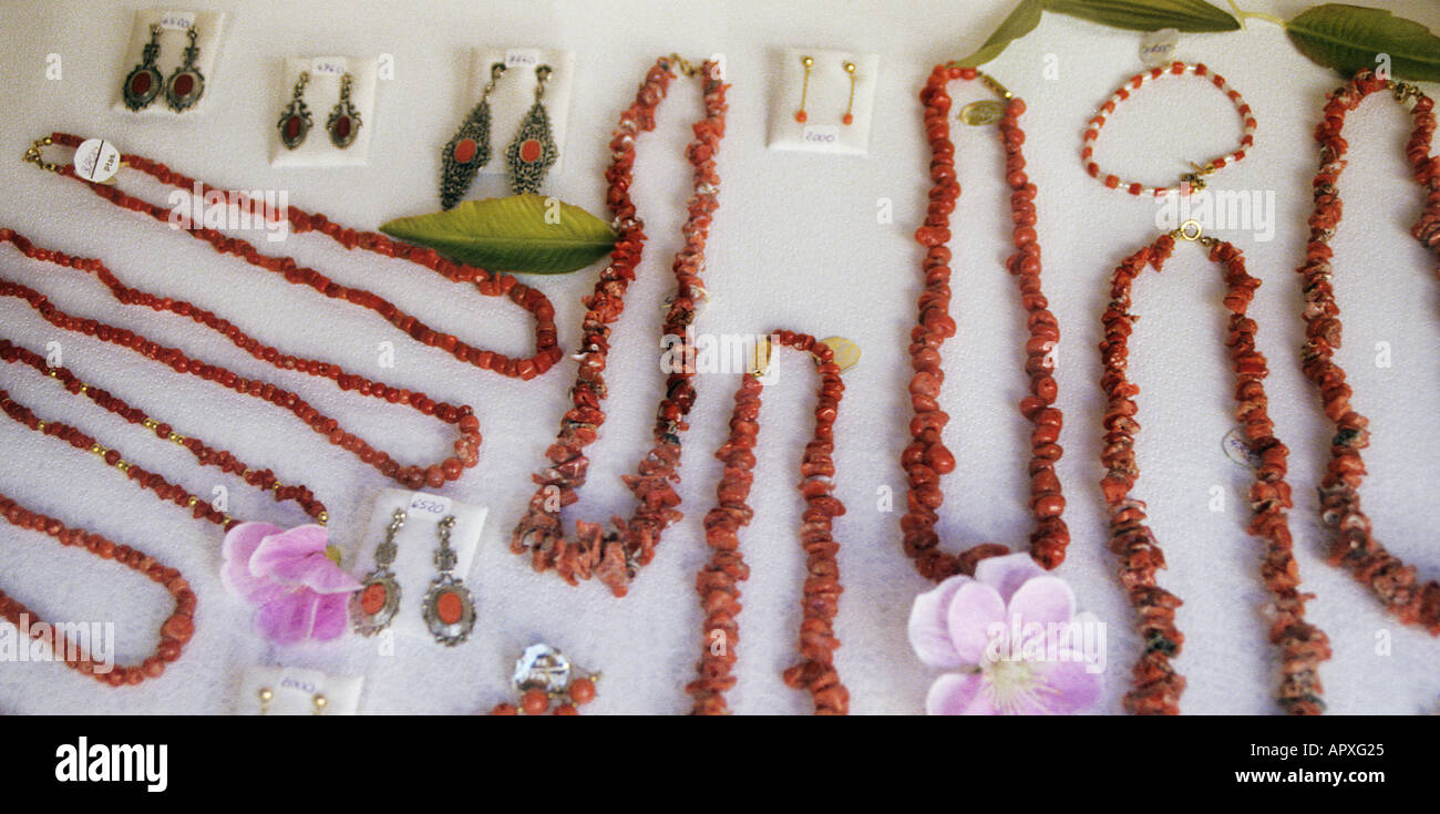 Coral and shell jewellery on sale in shop window Mallorca Spain Europe - Stock Image