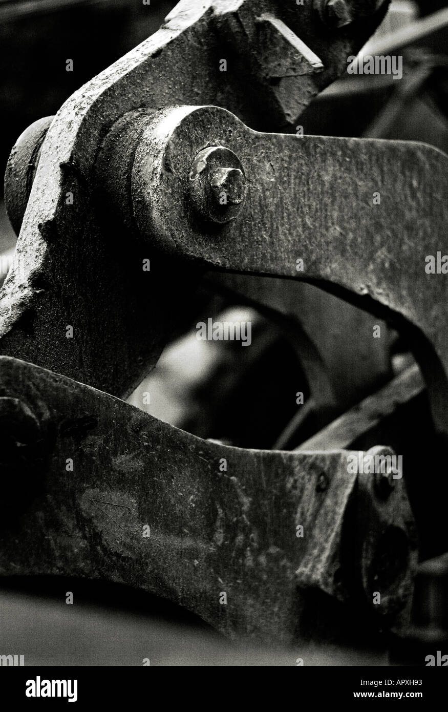 Detail of tractor metal hinges on shovel linkage Stock Photo