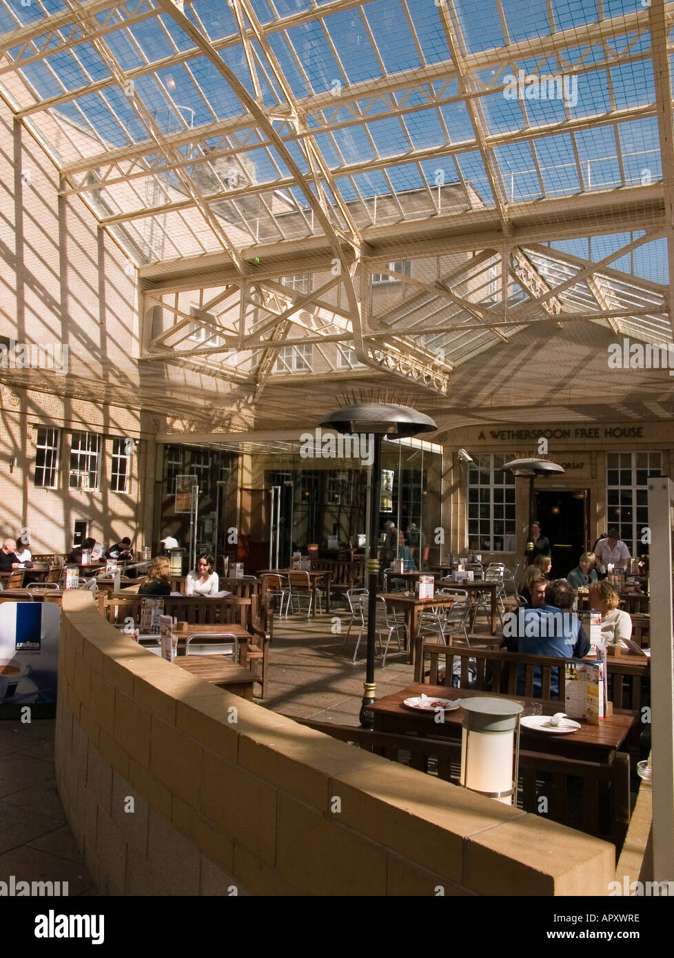 interior aberystwyth railway station with wetherspoons pub in the courtyard april 2005 under a glazed cast iron canopy - Stock Image