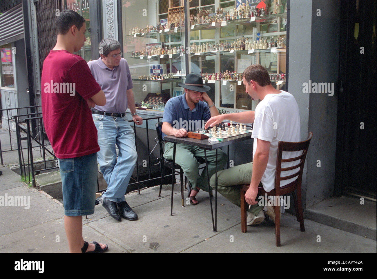 Men playing chess in the street in Greenwich Village in