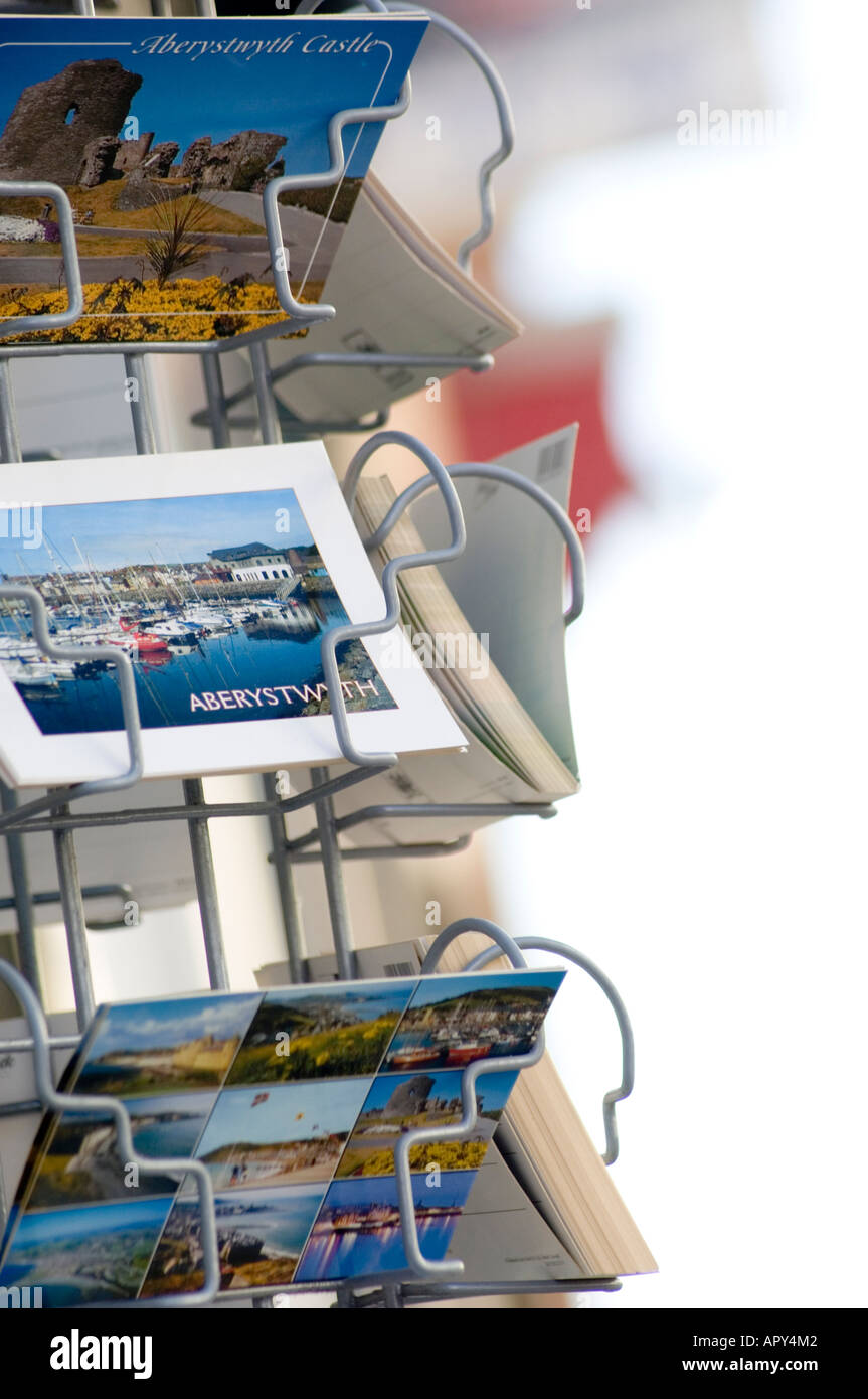 local view postcards in rack Aberystwyth Ceredigion Wales UK - Stock Image