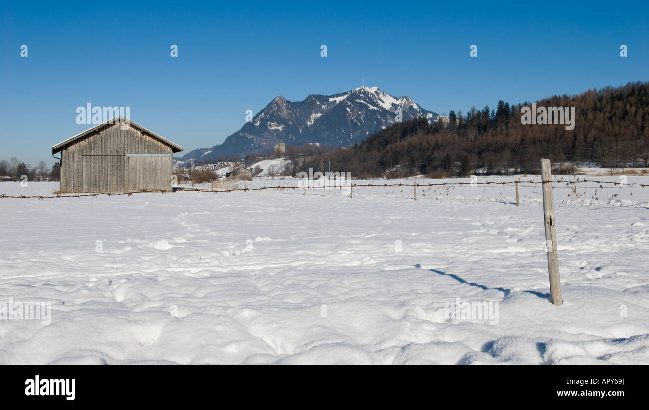 Winter landscape and Gruenten Mountain peak, between Altstaedten and Fischen Oberallgaeu Bavaria Germany Stock Photo