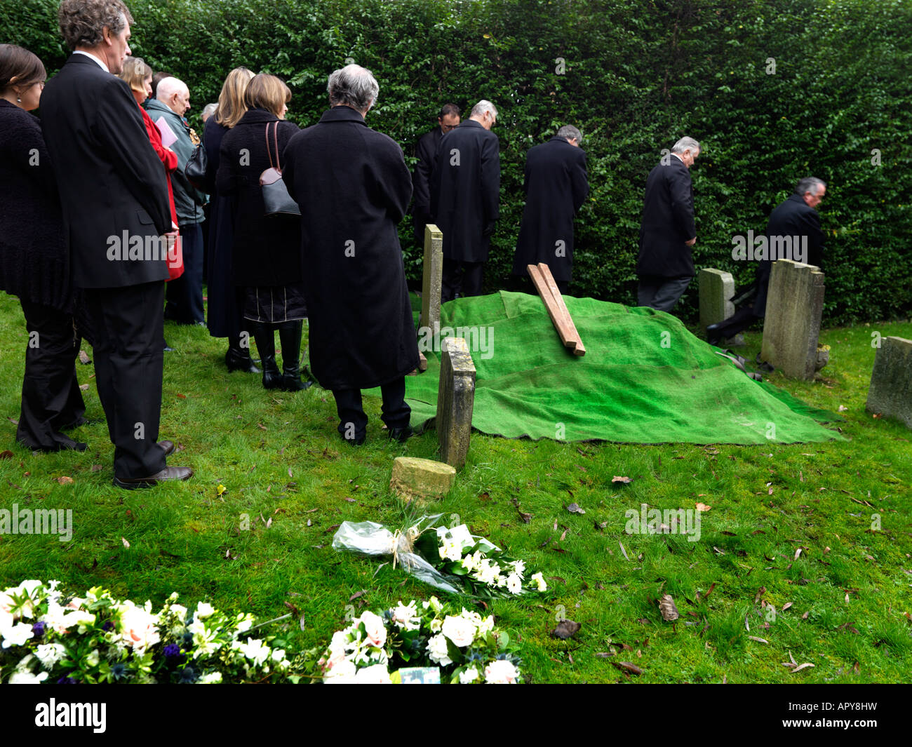 Funeral Saint Martins Church East Horsley Surrey England Family at Burial - Stock Image