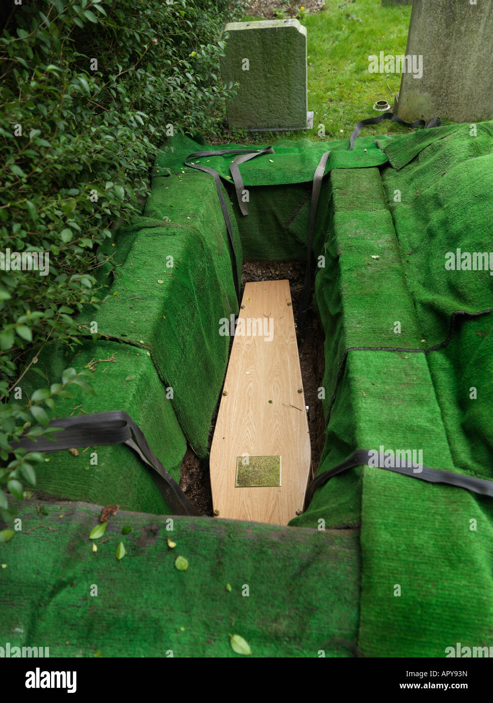 Funeral Saint Martins Church East Horsley Surrey England Coffin in open Grave - Stock Image