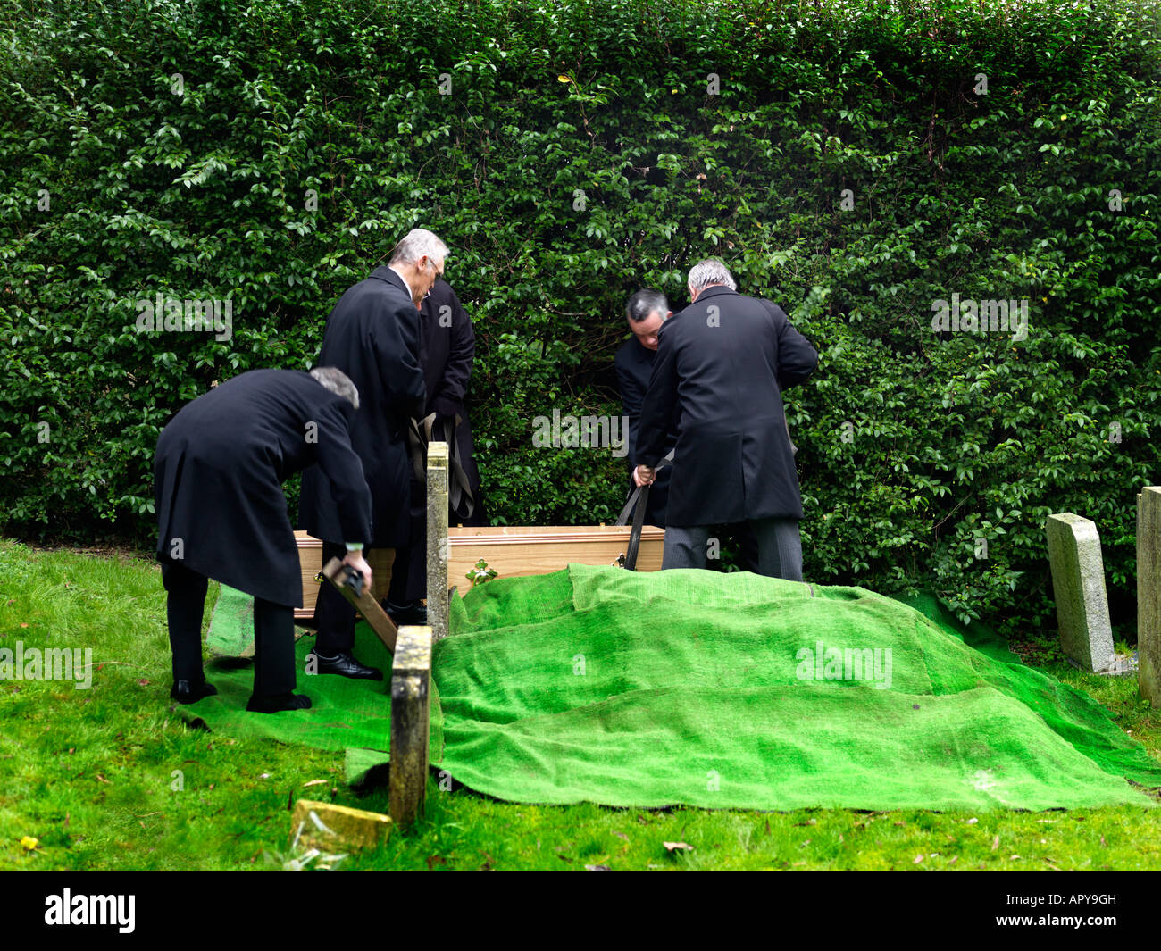 Funeral Saint Martins Church East Horsley Surrey England Lowering Coffin into Grave - Stock Image