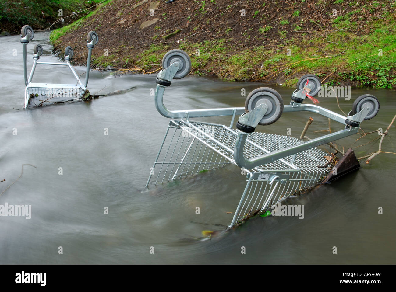Shopping Trollies Dumped in River. - Stock Image