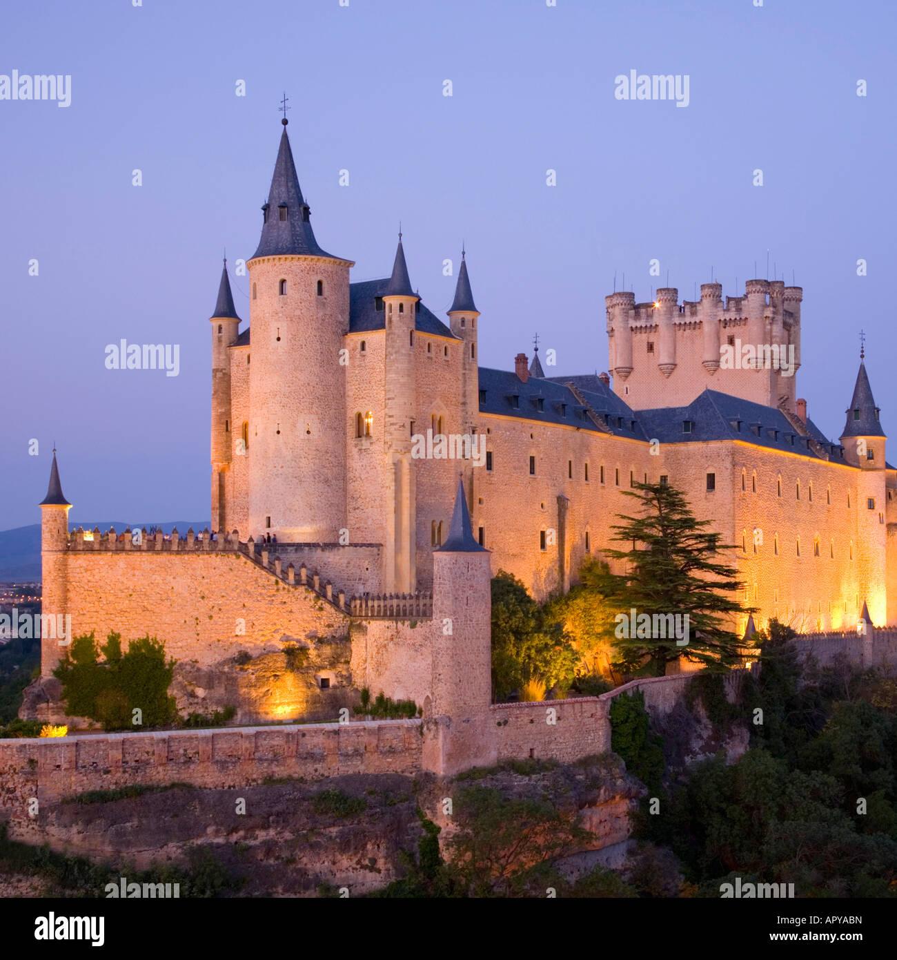 Segovia, Castile and León, Spain. The Alcázar illuminated at dusk. - Stock Image