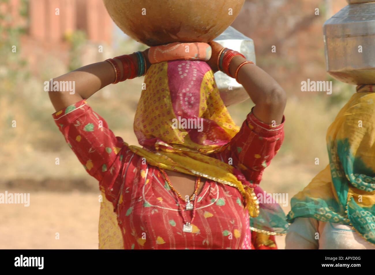 woman with waterjug in india - Stock Image