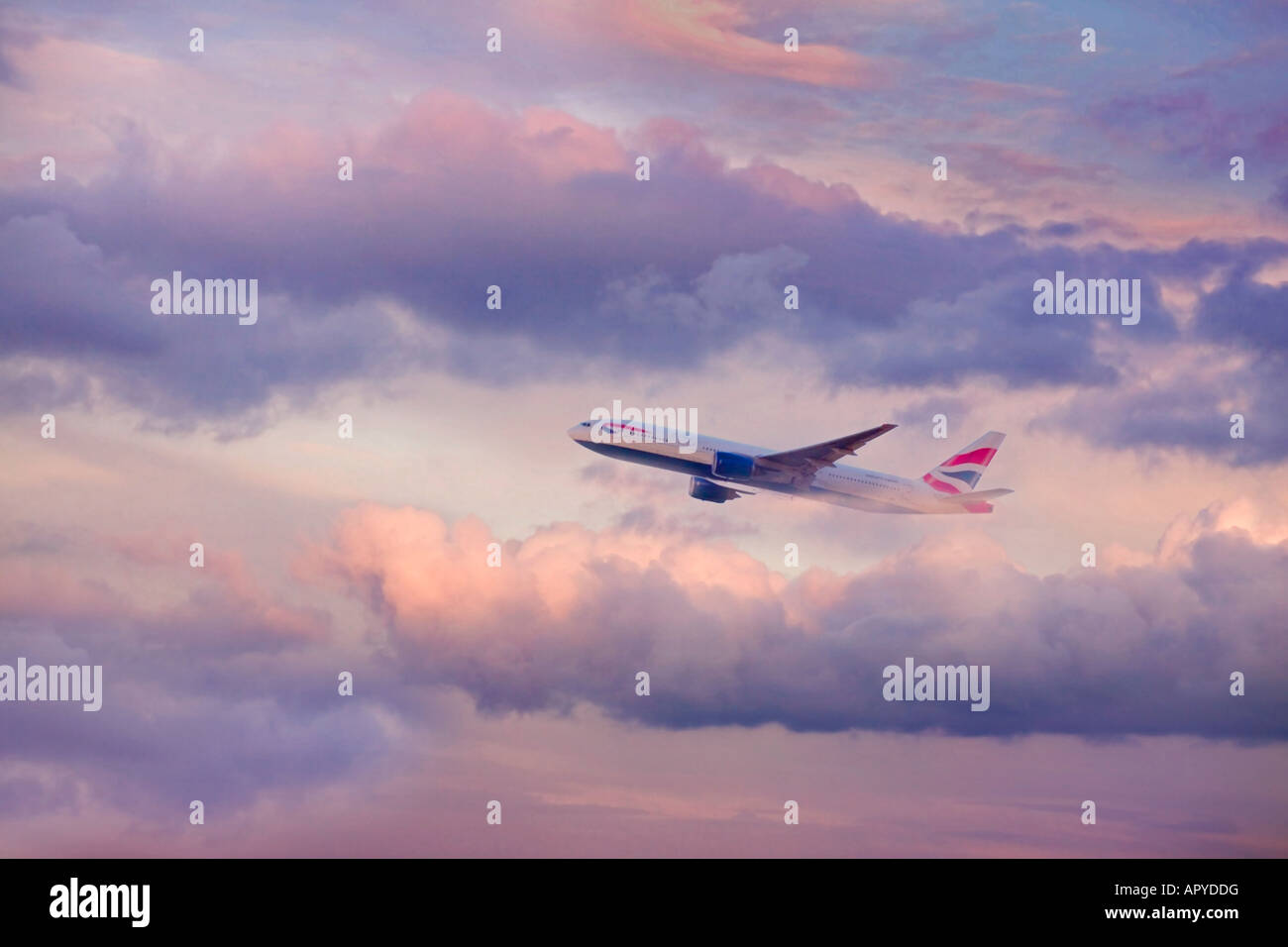 airoplane flying in dramatic sky - Stock Image