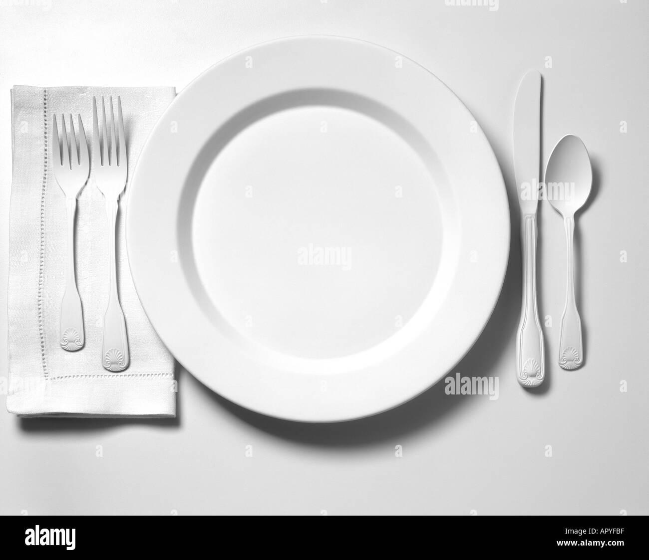 White plate and white utensils on white Stock Photo
