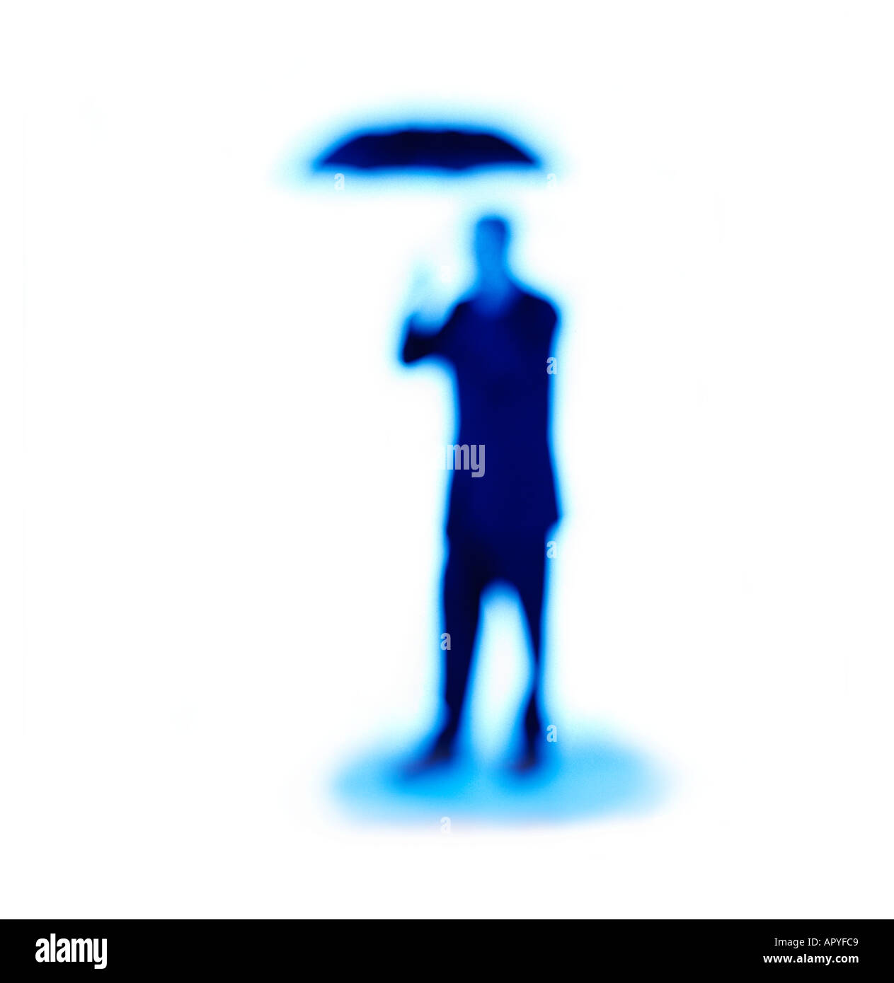 Out of focus Businessman holding umbrella Stock Photo