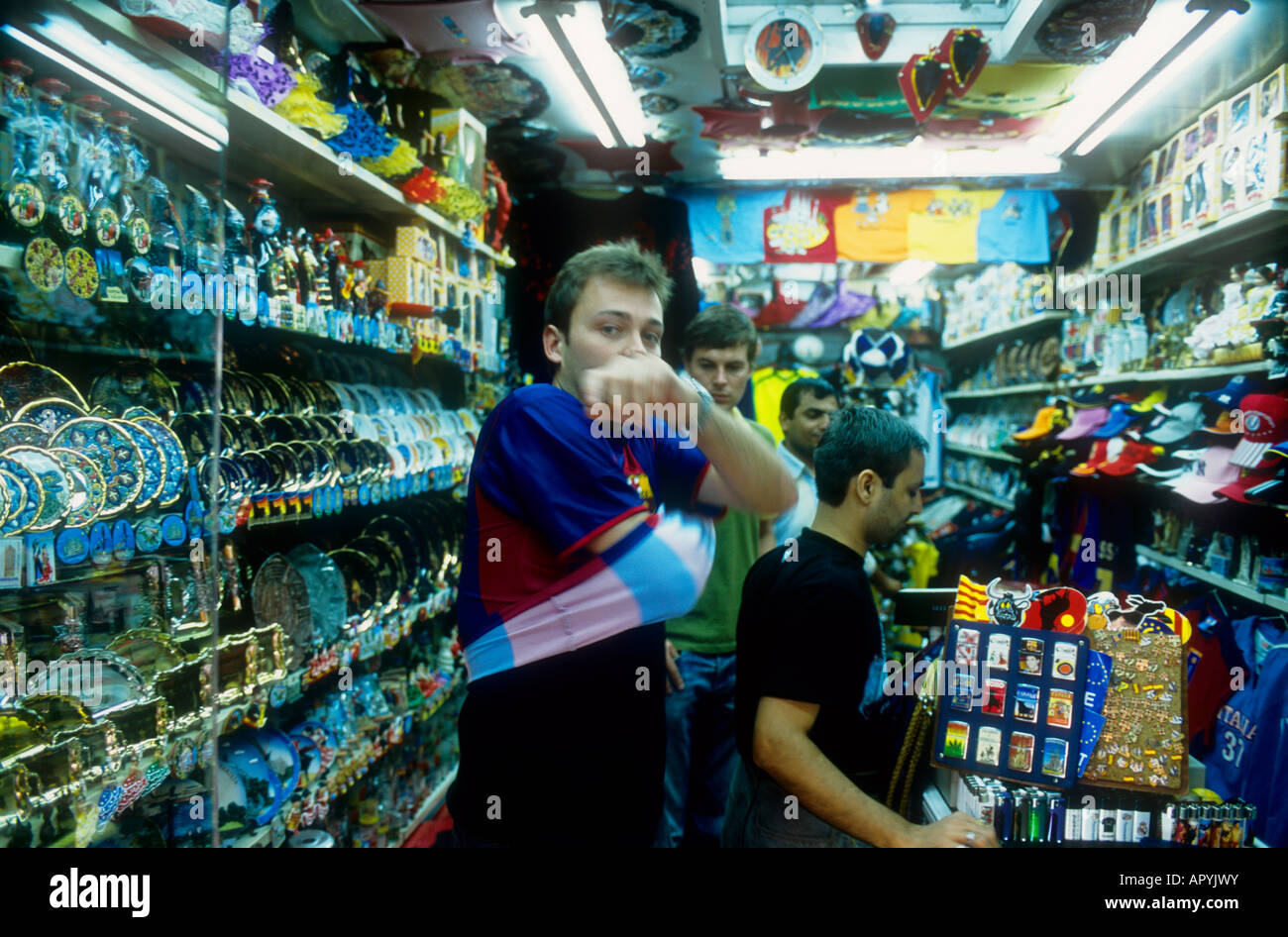 FC Barcelona football fan trying on the club shirt in a shop in Barcelona 9a8f7646fb8
