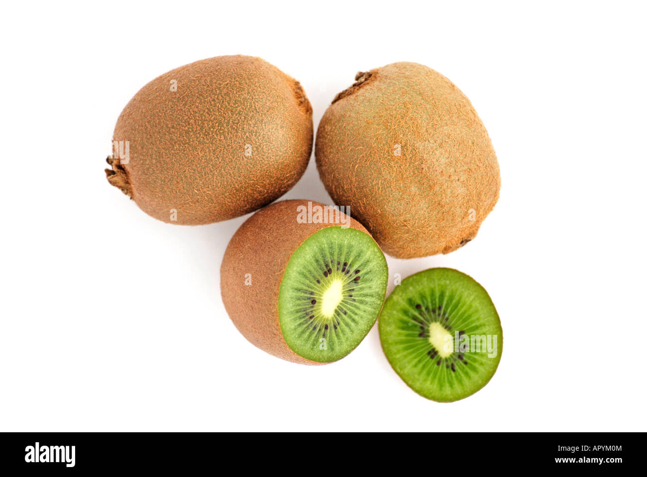 Two whole and one sliced Kiwi - Stock Image