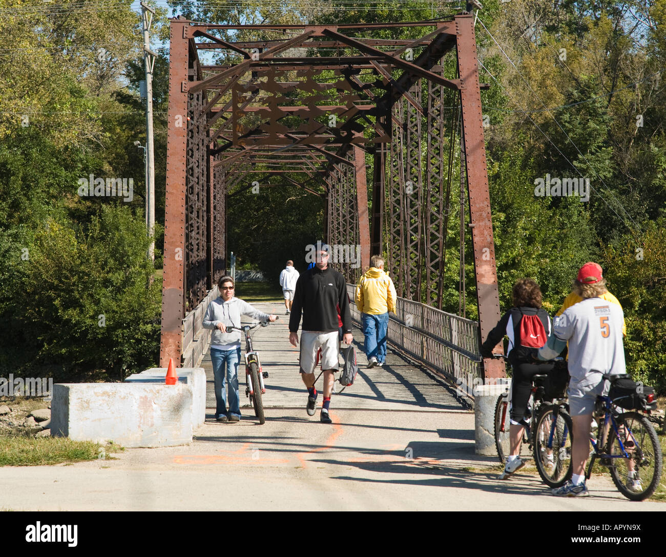 ILLINOIS Moline People walking and bicycling across bridge to Sylvan Island Park from Trailhead Park - Stock Image
