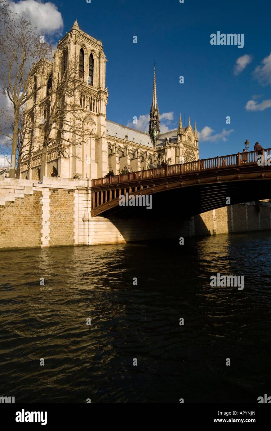Notre Dame Cathedral Pont au Double Seine Paris France - Stock Image