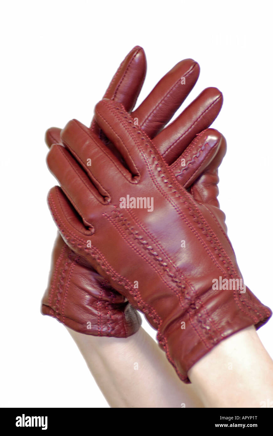 Pair of hands in Red Leather Gloves - Stock Image