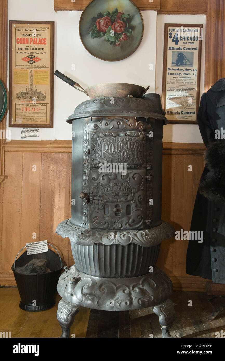 ILLINOIS Amboy Pot bellied stove and coal bucket Illinois Central Depot museum display - Stock Image
