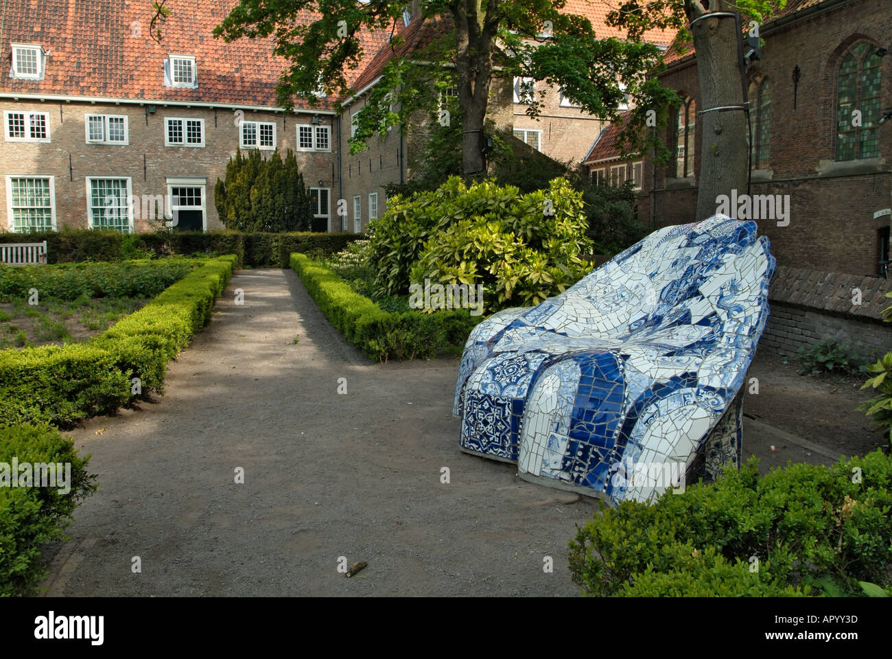 Chair made from Delft pottery Cloister garden of Sint Agathaklooster Delft Holland The Netherlands - Stock Image