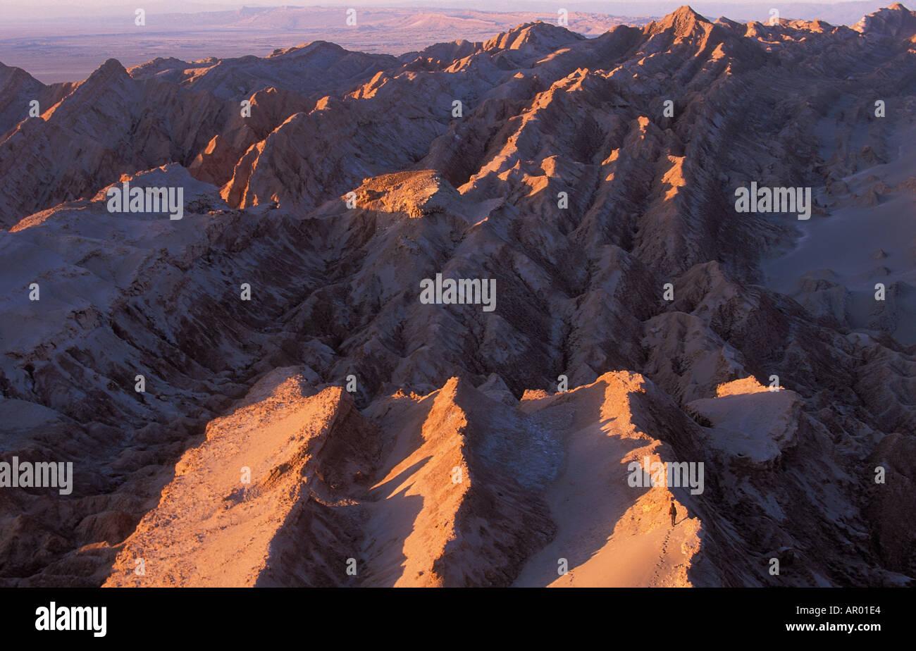 Solitary figure on ridge Atacama Desert Chile - Stock Image