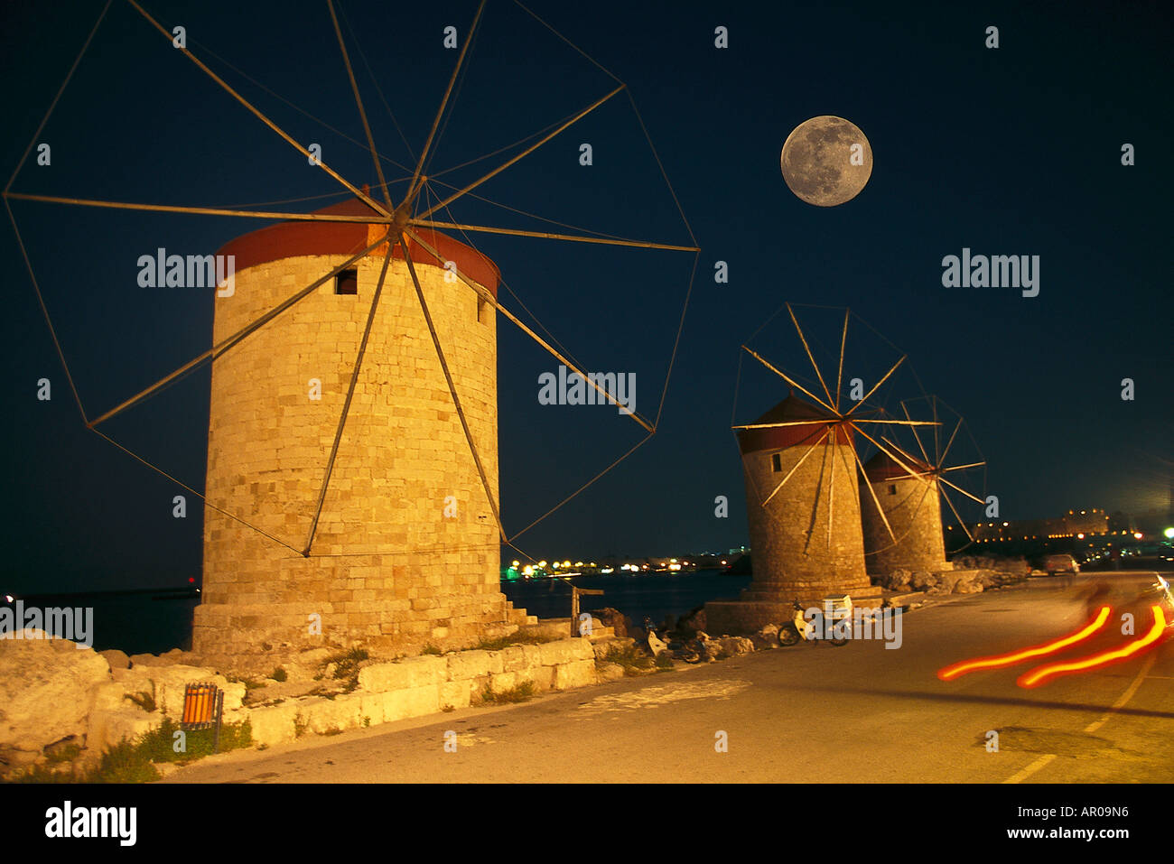 Rhodes windmills in the harbour at night, Rhodos City, Mandraki, Aegean, Greece - Stock Image
