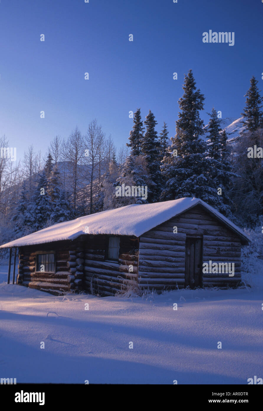 Rustic Log Cabin Summit Lake Chugach Natl Forest Southcentral Alaska Winter Snow Treee - Stock Image