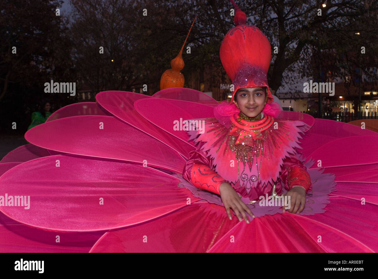 Young Girl In Red Flower Costume For Brent Diwali Parade Stock Photo