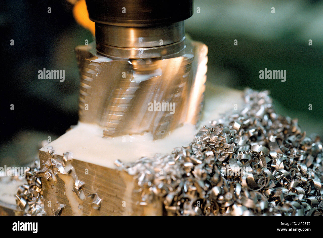Metal machining. Milling head cutting the surface of a workpiece - Stock Image
