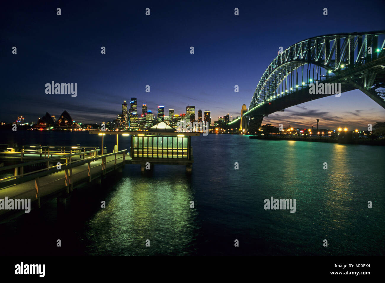 Sydney Harbour Bridge, at sundown. Jeffrey Street Wharf, North Shore, Australia - Stock Image