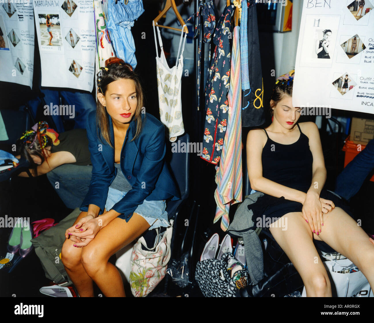 Models in various states of readiness wait patiently backstage at Boyd. - Stock Image
