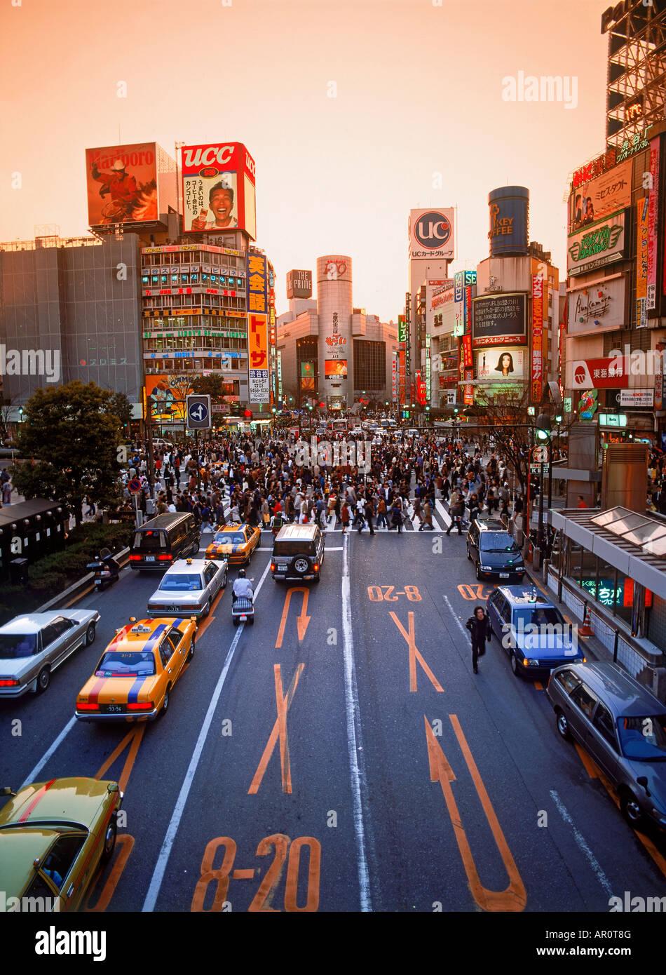 Pedestrians filling crosswalks in Shibuya district of Tokyo Stock Photo