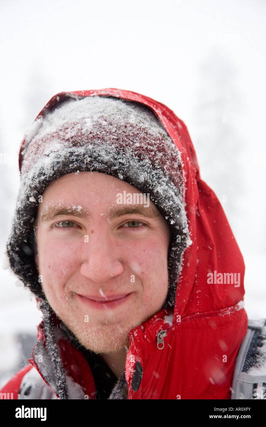 A young man snowshoer near Snoqulamie Pass WA - Stock Image
