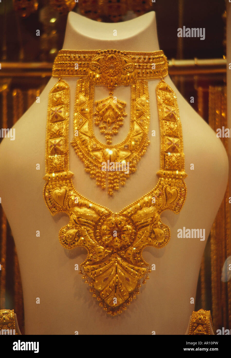 Close up of an exclusive golden necklace. - Stock Image