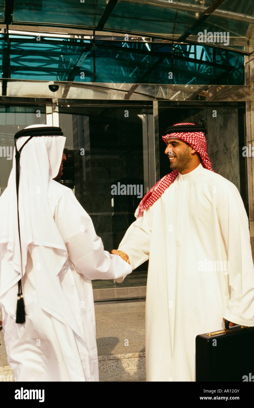 Arab men greeting other stock photos arab men greeting other stock two arabs greet each other outside the commercial building stock image m4hsunfo