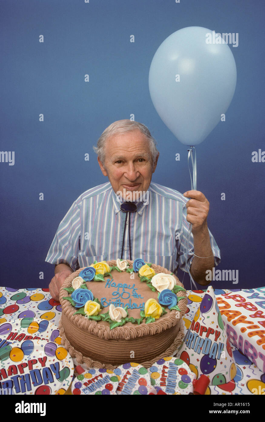 90 Year Old Man Holding Balloon With Birthday Cake Stock Photo