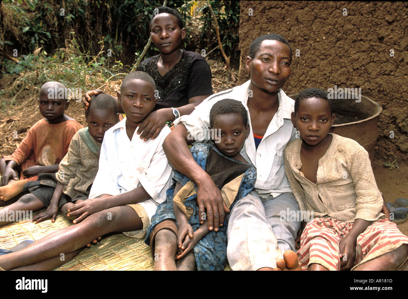 Rwandan genocide orphan Alfonse is mother and father to his younger siblings and his orphan cousins - Stock Image